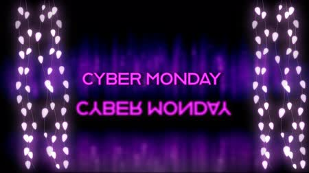 azaltmak : Animation of the words Cyber Monday in pink letters with reflection and strings of glowing fairy lights on purple background