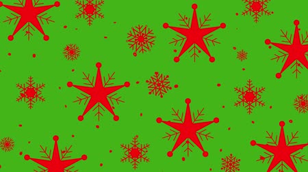 оберточной бумаги : Animation of red Christmas pattern of moving stars and snowflakes on green screen Стоковые видеозаписи