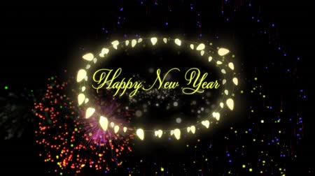 oválný : Animation of the words Happy New Year in yellow letters an oval frame of glowing fairy lights with fireworks on black background Dostupné videozáznamy