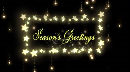 фасонный : Animation of the words Seasons Greetings in yellow letters a rectangular frame of glowing star shaped fairy lights with dropping lights in the background