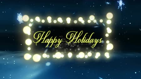 négyszögletes : Animation of the words Happy Holidays in yellow letters in a rectangular frame of glowing fairy lights with snowflakes in the background Stock mozgókép