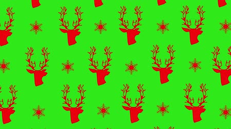 wrapping paper : Animation of red Christmas pattern with stars and reindeers on green screen