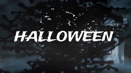 надгробная плита : Animation of the word Halloween in white letters with cross, castle and bats flying to camera with a giant moon in the background