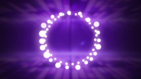 christmas spirit : Animation of a Christmas decoration with a circle of glowing fairy lights on a purple background