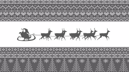 desenli : Animation of a grey silhouette of Santa Claus in sleigh being pulled by reindeers on a white background with patterned borders Stok Video