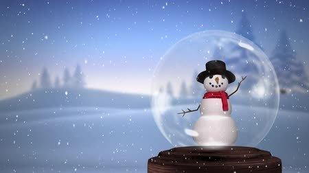 snow globe : Animation of a waving, blinking snowman in a snow globe, with a countryside winter scene and falling snow in the background Stock Footage