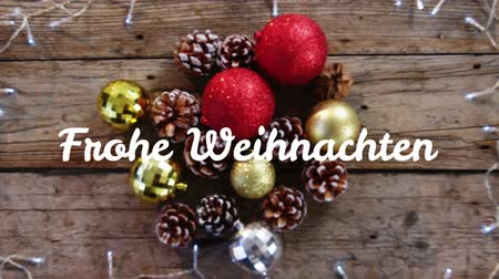 changing lights : Animation of the words Frohe Weihnachten written in white over Christmas decorations in the background Stock Footage