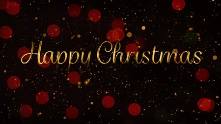 seasons changing : Animation of the words Happy Christmas in gold letters with glowing red spots of light in the background