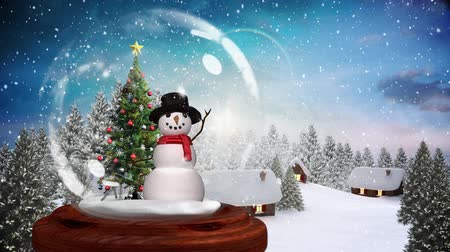 snow globe : Animation of a snowman standing beside a decorated Christmas tree in a snow globe, with a countryside scene with falling snow against a dusk sky in the background