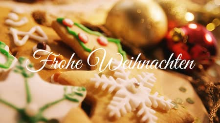changing lights : Animation of the words Frohe Weihnachten written in white with Christmas cookies in the background