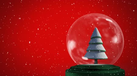 snow globe : Animation of a snow covered Christmas tree in a snow globe, with falling snow against a red background