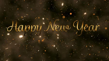 changing lights : Animation of the words Happy New Year in gold letters with fireworks and glowing spots of light in the background Stock Footage