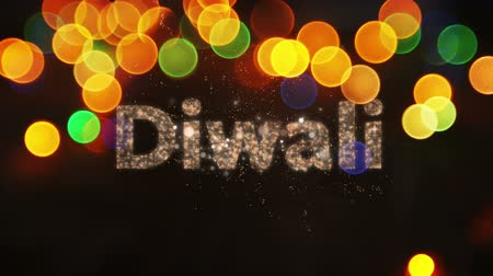 changing lights : Animation of the word Diwali in sparkling letters with fireworks and glowing spots of light in the background