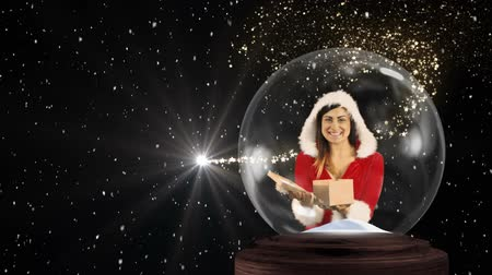 senhora : Animation of a happy young Caucasian woman wearing a Santa Claus outfit opening a gift in a snow globe, with snow falling on a black background
