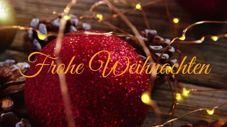 сосновая шишка : Animation of the words Frohe Weihnachten written in orange with Christmas decorations in the background