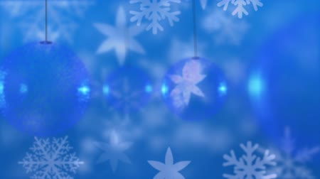 changing lights : Animation of snowflakes and blue Christmas baubles over blue background Stock Footage