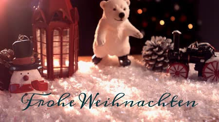 сосновая шишка : Animation of the words Frohe Weihnachten written in green with Christmas decorations in the background