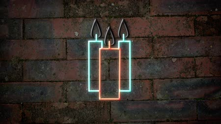 blue and yellow : Animation of flickering three candles neon sign in red and blue on brick wall Stock Footage