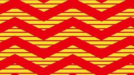 wrapping paper : Animation of red zig zag Christmas pattern with yellow moving stripes in the background