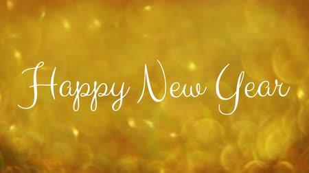 seasons changing : Animation of the words Happy New Year in white letters with yellow spots Stock Footage