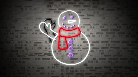 kardan adam : Animation of a flickering waving snowman neon sign in white, red and purple on brick wall Stok Video