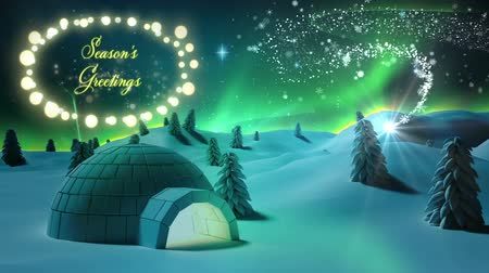 igloo : Animation of the words Seasons Greetings in yellow letters in an oval frame of glowing star shaped fairy lights with shooting star, igloo and winter scenery in countryaide Stock Footage