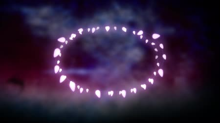 ovale : Animation of a Christmas decoration with an oval of glowing fairy lights on a purple background Filmati Stock