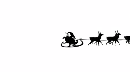 zima : Animation of a black silhouette of Santa Claus in sleigh being pulled by reindeers on a white background Wideo