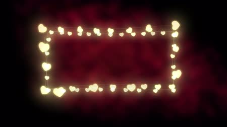 négyszögletes : Animation of a rectangular frame of glowing heart shaped fairy lights on a dark orange background