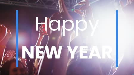 escrito : Animation of the words Happy New Year written in white letters with people enjoying themselves at a music concert in the background Vídeos