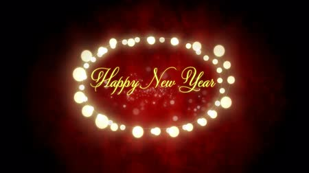 oval : Animation of the words Happy New Year written in yellow letters and in an oval frame of glowing fairy lights on red background Stock Footage