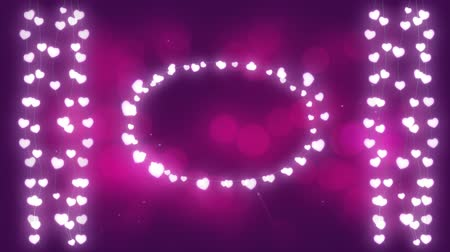 oval : Animation of a Christmas decoration with an oval and strings of glowing star shaped fairy lights on a pink background