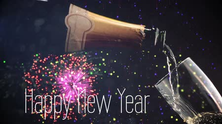 flaschenpost : Animation of the words Happy New Year written in white letters with champagne being poured and fireworks in the background