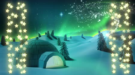 igloo : Animation of a Christmas decoration of strings of glowing star shaped fairy lights with a shooting star, snowflakes and igloo in the countryside