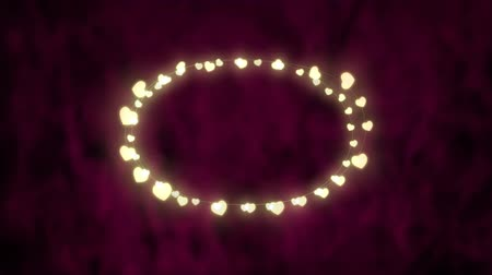 oválný : Animation of a Christmas decoration with an oval of glowing heart shaped fairy lights on a pink background