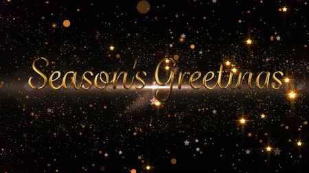 changing lights : Animation of the words Seasons Greetings in gold letters with glowing spots of light in the background