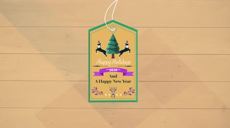 bin : Animation of the words Happy Holidays 2020 and A Happy New Year written on a beige label decorated with reindeer and a Christmas tree with a beige panels in the background