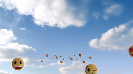 risonho : Animation of a group of emoji icons flying over sky with clouds Vídeos