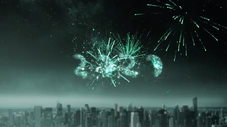 seasons changing : Animation of number 2020 in sparkling green letters with fireworks in the background