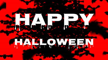 tüm : Animation of the words Happy Halloween written in dripping white letters, with lots of black bats flying to the foreground, on a red background