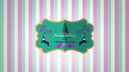 bin : Animation of the words Happy Holidays and A Happy New Year 2020 written on a green label decorated with reindeer, a Christmas tree and peuple leaves, with pink, white and green stripes in the background Stok Video