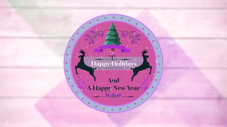 sob : Animation of the words Happy Holidays and A Happy New Year written on a round pink label decorated with reindeer, a Christmas tree and falling snow, on a pale pink panelled background