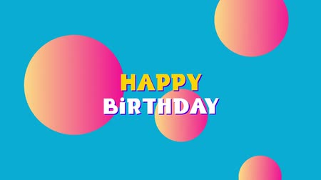 fuvalom : Animation of the words Happy Birthday in yellow and white letters appearing in a puff of smoke with floating pink and orange spheres on a blue background