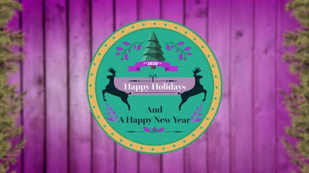 sob : Animation of the words Happy Holidays and A Happy New Year written on a round green label decorated with reindeer, a Christmas tree and purple leaves, on a pink panelled background
