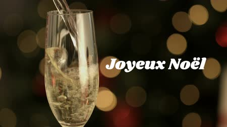 changing lights : Animation of the words Joyeux Noᅢᆱl written in white with champagne being poured over flickering lights in the background Stock Footage