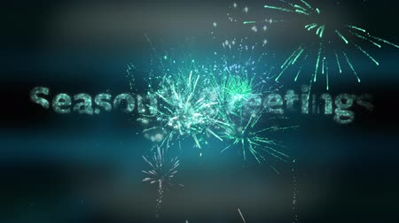 changing lights : Animation of the words Seasons Greetings in sparkling green letters with fireworks and glowing spots of light in the background Stock Footage