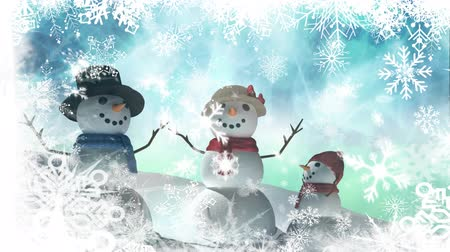 seasons changing : Animation of three snowmen, snow, stars and snowflakes falling on blue background