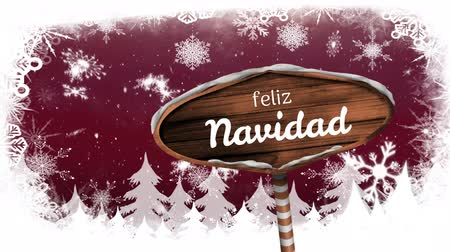 Навидад : Animation of the words Feliz Navidad written on wooden sign board with snowflakes falling and fir trees on red background Стоковые видеозаписи