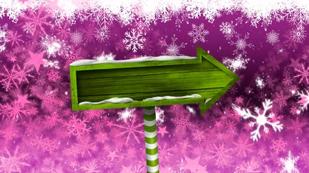 seasons changing : Animation of snowflakes and stars falling and green wooden arrow sign board on pink background