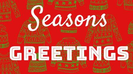 ugró : Animation of the words Seasons Greetings written in white letters over green jumpers and hats on red background